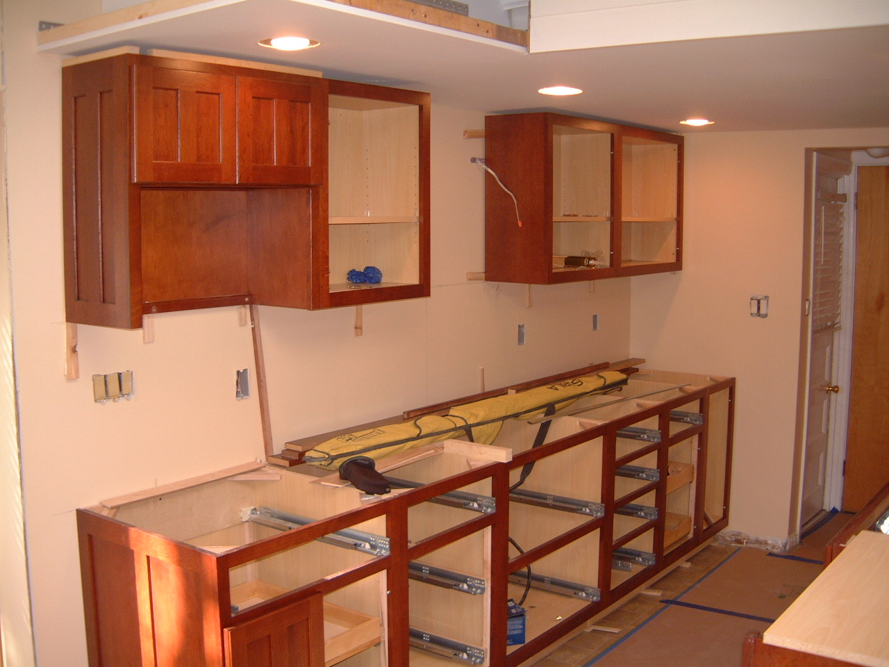 The Base And Upper Cabinets Have Been Installed On The Sink Wall You