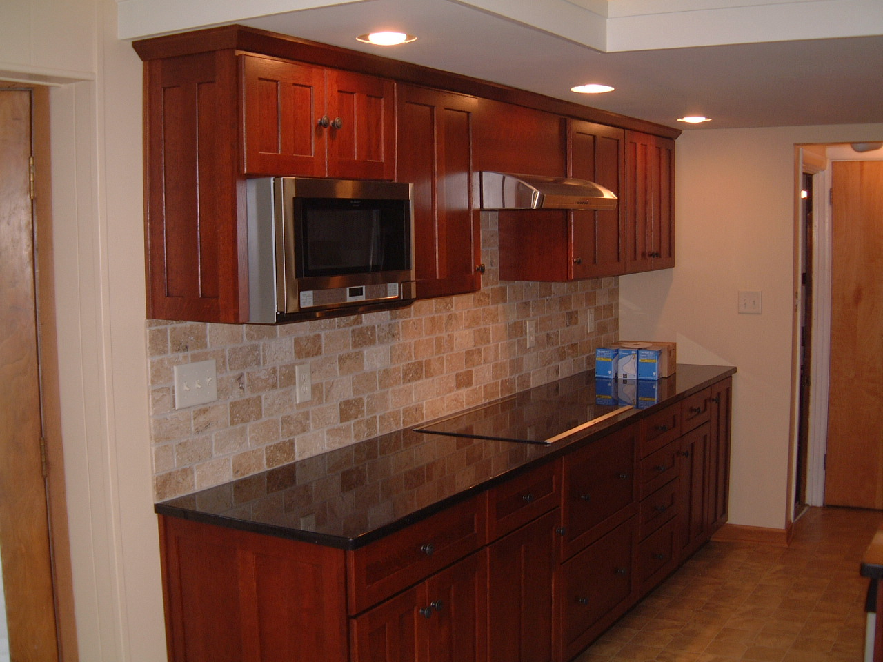 Springfield Kitchen - Project Complete - Remodeling Designs, Inc. on black galaxy kitchen ideas, black galaxy tile, black granite backsplash ideas, black galaxy kitchen countertops,